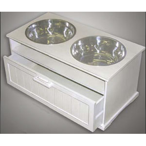 elevated white wood dog diner with dog food storage